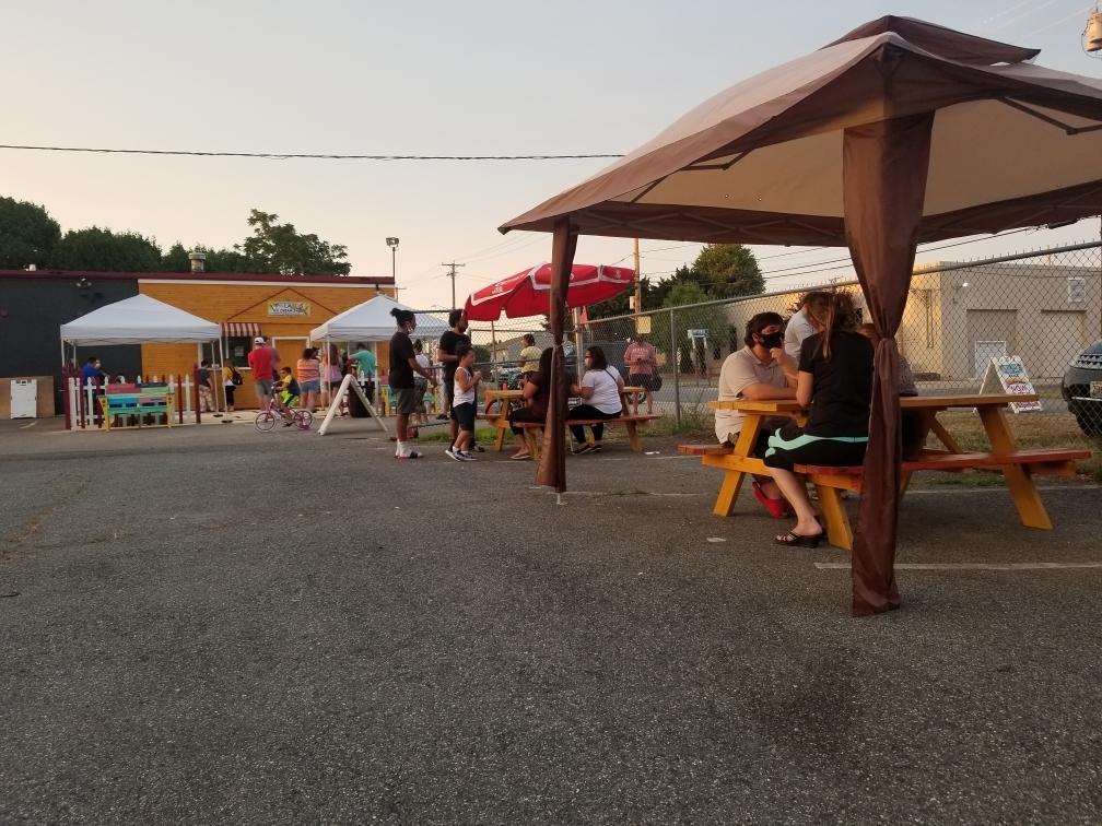 people eating ice cream at ice cream shack